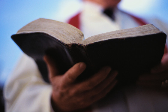 Pastor Holding Bible